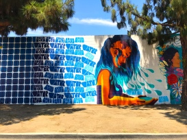 When looking at this mural, designed by Kristy Sandoval supported by members of the EL NIdo Family Centers and Community, don't miss the map on the scalp of the central figure.